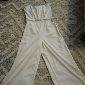 Have wide cropped leg and sleeveless romper